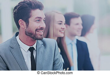 group of business people smiling in an office