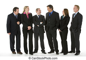 Group Of Business People Standing Around Conversing