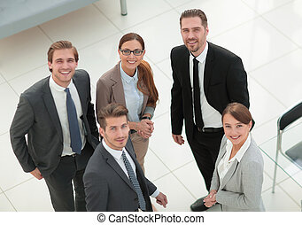group of business people standing in a Bank office