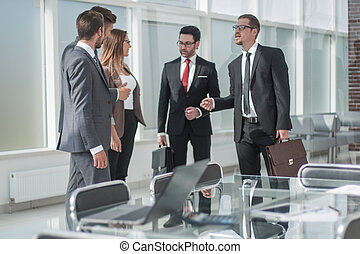 group of business people standing in the office.