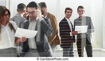 group of business people standing in the office lobby