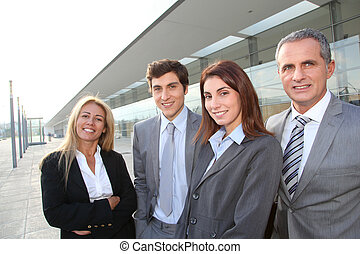Group of business people standing outside conference building