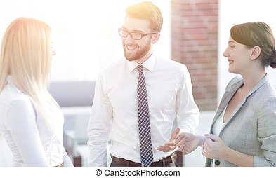 group of business people talking in office