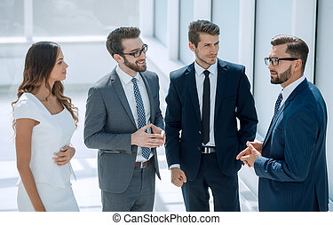 group of business people talking ,standing in the office