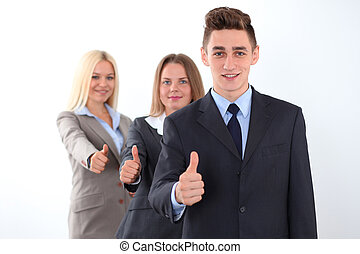 Group of business people, thumbs up