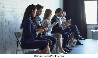 Group Of Business People Using Cell Smart Phones Typing...