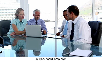 Group of business people using tabl