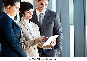 business people using tablet computer - group of business...