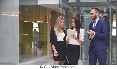 Group of business people using tablet computer during a meeting