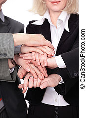group of business people with hands clasped together.