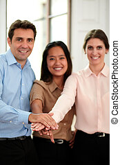 Group of business people with hands together