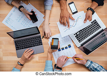 Group of business people working for a financial report