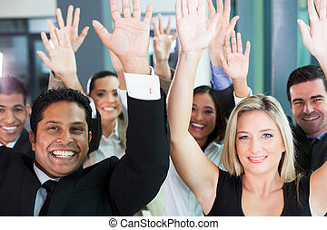 group of business team raising hands
