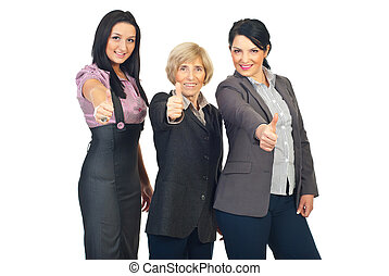 Group of business women giving thumbs