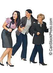Group of business women running