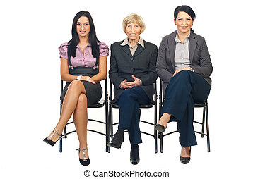 Group of business women sit on chair - Row of business women...