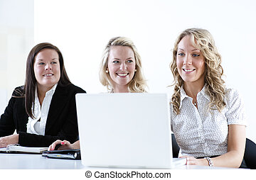 Group of business women at the office working