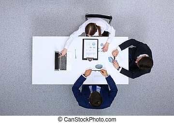 Group of businesspeople analyzing financial documents, view from above. Business team at meeting