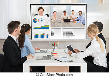 Businesspeople Attending Video Conference - Group Of...