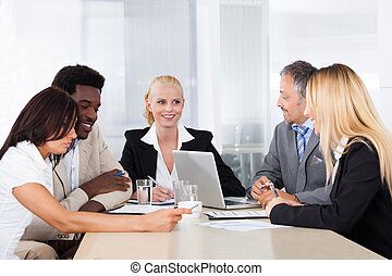 Group Of Businesspeople Discussing Together