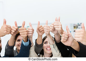 Group of businesspeople giving a thumbs up