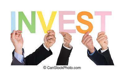 Group Of Businesspeople Hands With Text Invest