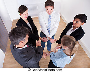 Group Of Businesspeople Holding Hands