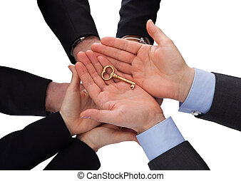 Group Of Businesspeople Holding Key