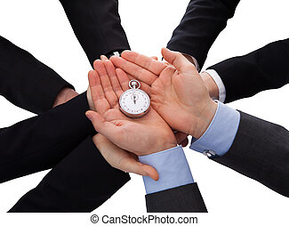 Group Of Businesspeople Holding Stopwatch