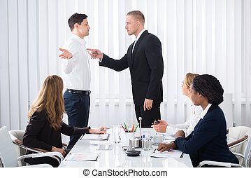 Businessman Blaming His Colleague In Meeting