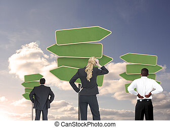 Group of businesspeople looking at