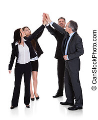 Group Of Businesspeople Raising Hand Together