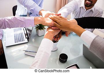 Group Of Businesspeople Stacking Hands