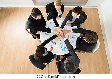 Businesspeople Stacking Hands Together - Group Of...