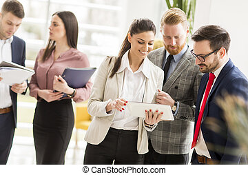 Group of businesspeople standing in the modern office