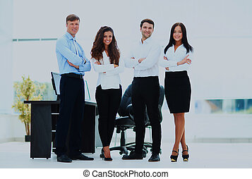 group of businesspeople standing together in office.