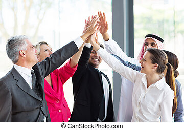 group of businesspeople teambuilding - group of cheerful ...