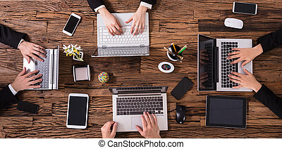 Group Of Businesspeople Using Laptop
