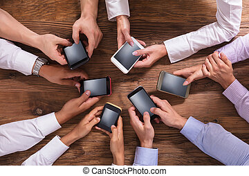 Group Of Businesspeople Using Smartphone