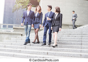 businesspeople walking down the stair