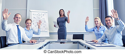 group of businesspeople waving hands in office