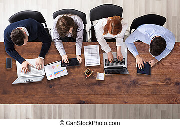 Group Of Businesspeople Working In Office