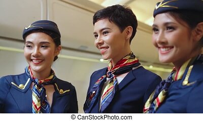 Group of cabin crew or air hostess in airplane . Airline ...
