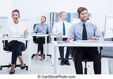 Group of call centre workers