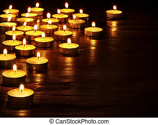 Group of candles on black background. - Group of burning ...