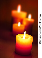 group of candles with the focus on first candle