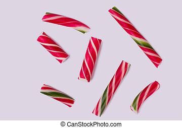 Group of candy canes on white background.