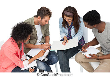 Group of casual young people in meeting over white...