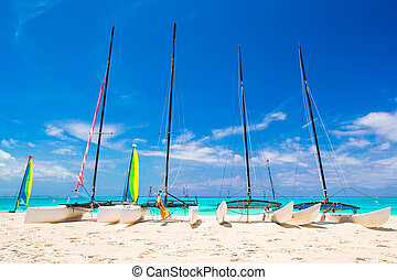 Group of catamarans with colorful sails on exotic Caribbean ...