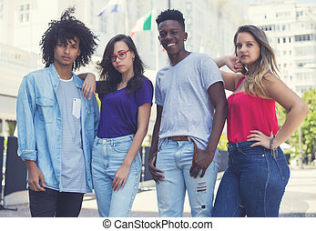 Group of caucasian and latin american and african young adults